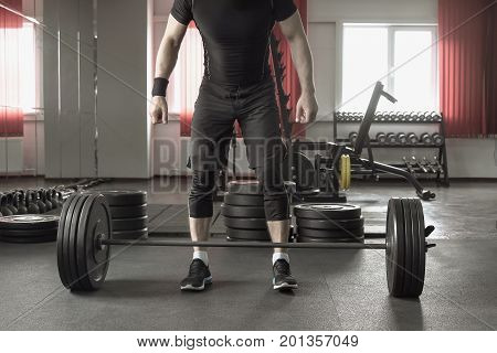 Close Up Of Man Doing Deadlift Exercise In Gym.