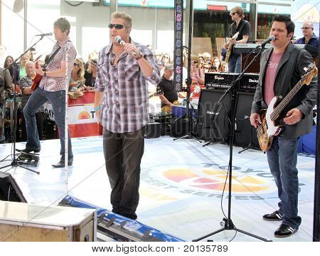 NEW YORK - JUNE 11: Guitarist Joe Don Rooney, singer Gary Levox and bassist Jay DeMarcus of Rascall Flatts perform on NBC's 'Today in Rockefeller Plaza on June 11, 2010 in New York City.