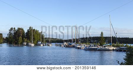 HEINOLA, FINLAND ON JULY 01. View of a marina this side a forest by the lakeside on July 01, 2017 in Heinola, Finland. Evening and sunshine. Editorial use.