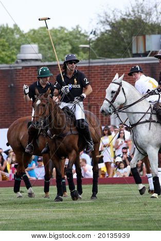 NEW YORK - MAY 30: HRH Prince Harry competes in the Veuve Clicquot Manhattan Polo Classic at Governors Island on May 30, 2009 in New York City.