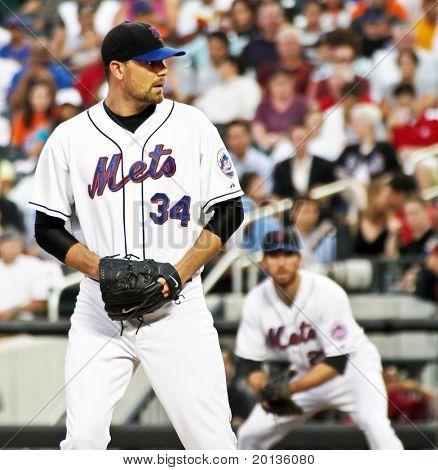 FLUSHING - JULY 30: New York Mets pitcher Mike Pelfrey plays baseball at CitiField Park against the Arizona Diamondbacks on July 30, 2010 in Flushing, New York.