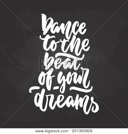 Dance to the beat of your dreams - lettering dancing calligraphy quote drawn by ink in white color on the black chalkboard background. Fun hand drawn lettering inscription