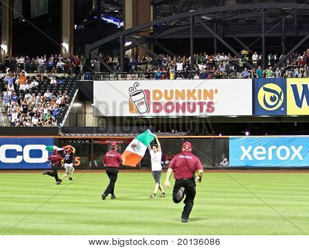 FLUSHING - JULY 30: A protester enters the outfield at CitiField Park during the New York Mets against Arizona Diamondbacks ballgame on July 30, 2010 in Flushing, New York.