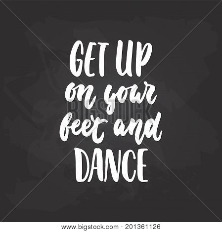 Get up on your feet and dance - lettering dancing calligraphy quote drawn by ink in white color on the black chalkboard background. Fun hand drawn lettering inscription