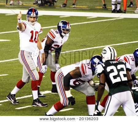 EAST RUTHERFORD, NJ - AUGUST 16: New York Giants Quarterback Eli Manning in action against the New York Jets at the new Meadowlands arena on August 16, 2010 in East Rutherford, New Jersey.