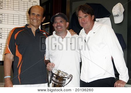 EAST HAMPTON - AUGUST 22: Jimmy Connors, Michael Milken and Larry McCarthy attend the Charles Evans PCF Pro-Am Tour benefiting the Prostate Cancer Foundation at the Ross School Tennis Facility on August 22, 2010 in East Hampton, NY.