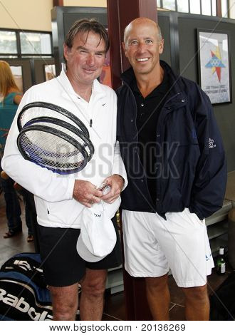 EAST HAMPTON - AUGUST 22: Jimmy Connors and Barry Sternlicht attend the Charles Evans PCF Pro-Am Tour benefiting the Prostate Cancer Foundation at the Ross School Tennis Facility on August 22, 2010 in East Hampton, NY.