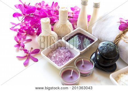 Thai Spa Treatments aroma therapy salt and sugar scup and rock massage with orchid flower on wooden white. Healthy Concept. copy spaceselect and soft focus