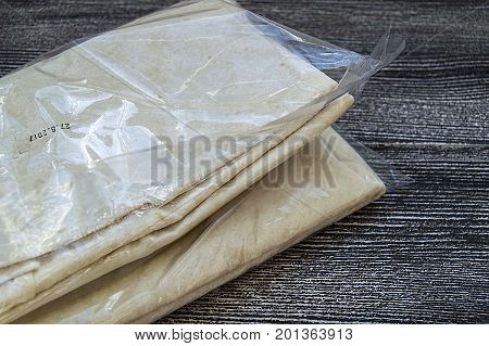 Fine dough, thin raw dough for making pie, pastry dough, ready-to-use fine dough hummer taken from the market,