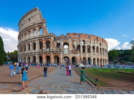 Rome Italy - September 12 2016: Tourists are taking pictures near of the famous sightseeing and monument in the world -  the Flavian Amphitheatre in Rome.