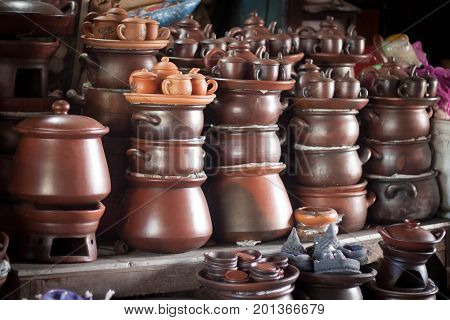 a traditional tea pot pottery handmade sale at store with stack java