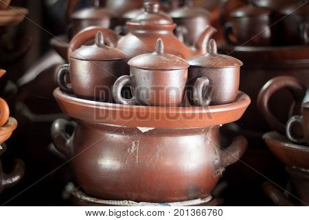 a set of traditional tea pot pottery handmade sale at store with stack java