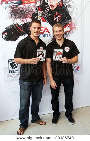 NEW YORK - SEPTEMBER 8: Jonathan Toews (L) and Patrick Kane (R) of the Chicago Blackhawks, attend the launch event for EA Sports' NHL 11 at the Reebok store on September 8, 2010 in New York City.