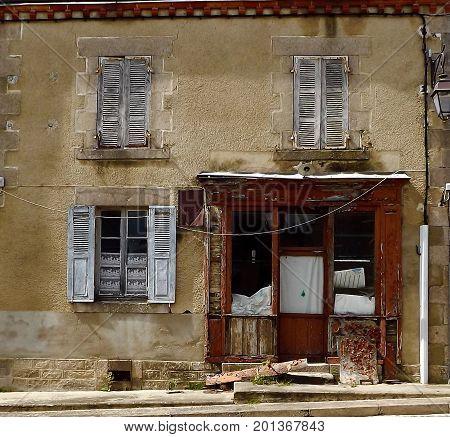 Delapidated shop front in rural central France