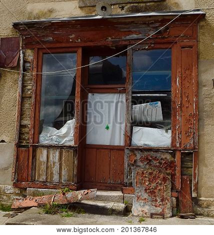 Derelict shop in state of decay in rural France