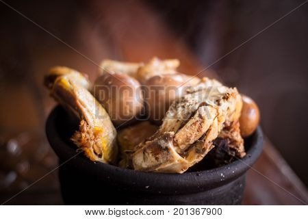 gudeg traditional exotic indonesian food with kendil and wooden table java