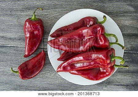 Red Hot Chili Peppers over wooden background the most wonderful Red hot pepper pictures for web and graphic design