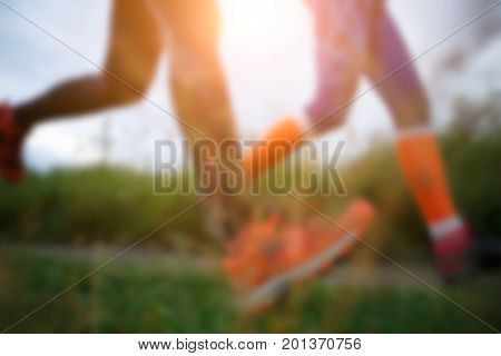 Blurred photo from below of two running women in forest