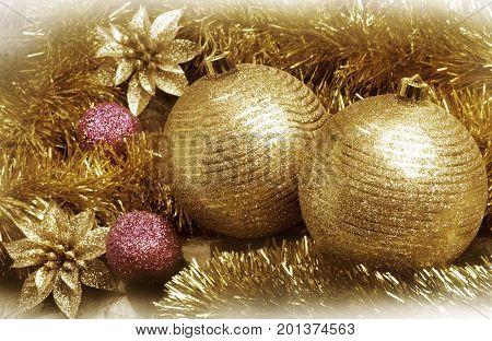 Vivid and colorful Christmas still life. Close Up view of golden christmas balls set.