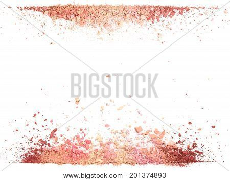 Samples of dry blush, powder, bronzers and highlighter scattered in line isolated on white background