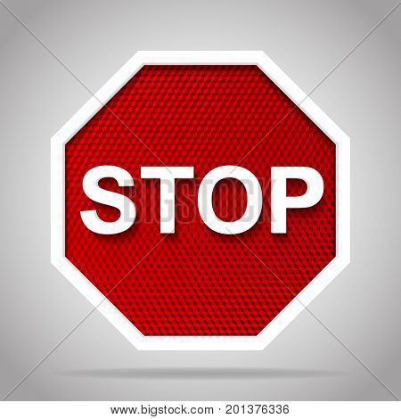 Stop road sign with white frame on red reflective background
