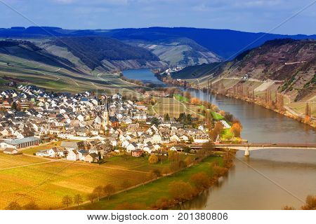 MOSELTAL GERMANY - MARCH 26 2016: Panoramic view over the Moselle valley in the background the vineyards and the River Moselle.