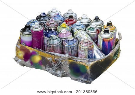 Spray cans of aerosol paint in a cardboard box isolated on a white background