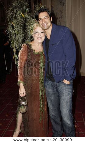 NEW YORK - OCTOBER 29: Actors Bette Midler and Gilles Marini attend the 15th Annual Bette Midler's New York Restoration Project's Hulaween at the Waldorf-Astoria Hotel on October 29, 2010 in New York City.