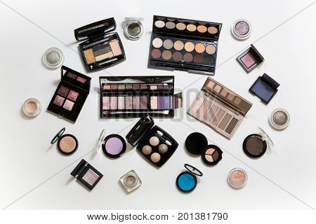 Many different palettes of eye shadow. Top view