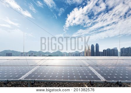 solar panel with cityscape of chongqing in blue cloud sky