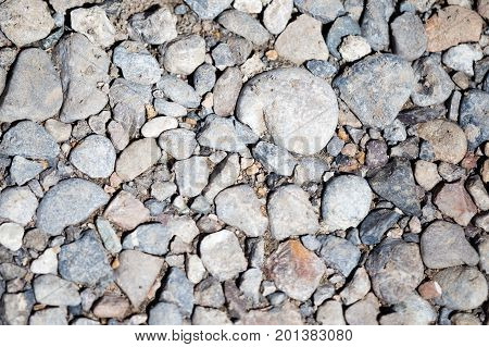 Round stones on nature as an abstract background