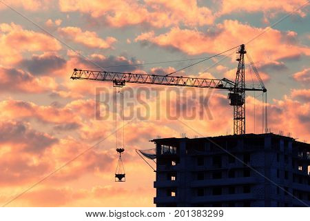 Construction Of The Building At Sunset