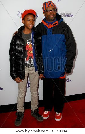 "NEW YORK, NY - FEBRUARY 02: Spike Lee and son, Jackson, attend the ""Justin Bieber: Never Say Never"" New York movie premiere at the Regal E-Walk 13 Theater on February 2, 2011 in New York City."