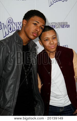 """NEW YORK, NY - FEBRUARY 02: Diggy and Russell Simmons attend the """"Justin Bieber: Never Say Never"""" New York movie premiere at the Regal E-Walk 13 Theater on February 2, 2011 in New York City."""