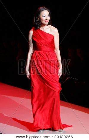 NEW YORK - FEBRUARY 9:  Ann Curry walks the runway at The Heart Truth's Red Dress Fashion Show during Mercedes-Benz Fashion Week at Lincoln Center on February 9, 2011 in New York City.