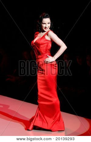 NEW YORK - FEBRUARY 9:  Dita Von Teese walks the runway at The Heart Truth's Red Dress Fashion Show during Mercedes-Benz Fashion Week at Lincoln Center on February 9, 2011 in New York City.