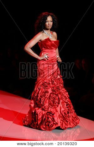NEW YORK - FEBRUARY 9: Actress Garcelle Beauvais walks the runway for the Heart Truth's Red Dress Collection during Mercedes-Benz Fashion Week at Lincoln Center on February 9, 2011 in New York City.