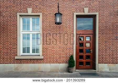 Red Brick Town House old door with white window