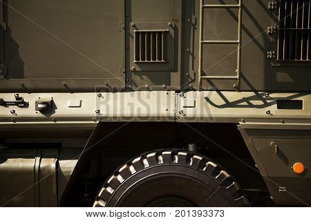 Khaki military vehicle close-up. Russian army transport background