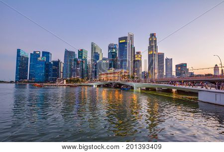 Singapore, Singapore - August 12, 2017: View at Singapore City Skyline during the sunset, which is the iconic landmarks of Singapore.