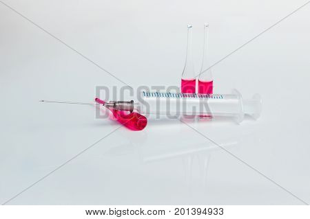 Syringe. Syringe on white background with ampoules of vaccine. Concept medicine.