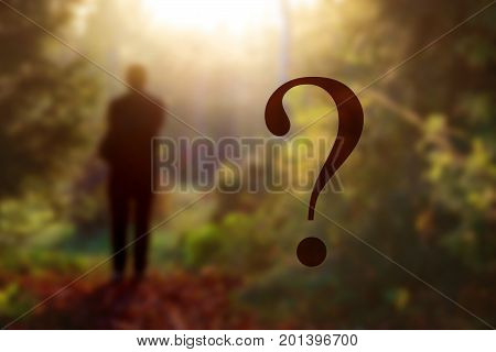 fantasy forest landscape. Mysterious surreal light in gloomy dark forest with fog between trees and man walking on natural path. mystery concept