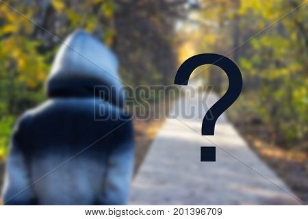 person in a hood and a road. unknown future fate concept