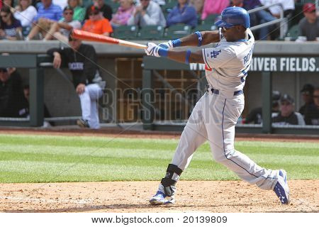 SCOTTSDALE, AZ - MARCH 7: Los Angeles Dodgers outfielder Trayvon Robinson takes a swing against the Colorado Rockies at Salt River Fields at Talking Stick on March 7, 2011 in Scottsdale, AZ.