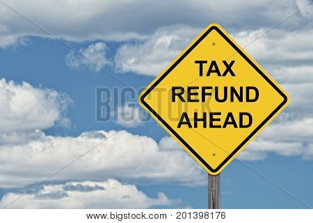 Caution Sign Blue Sky Background - Tax Refund Ahead