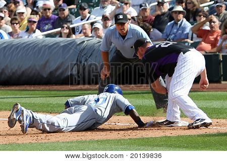 SCOTTSDALE, AZ - MARCH 7: Los Angeles Dodgers outfielder Tony Gwynn Jr avoids a tag by Colorado Rockies infielder Ty Wigginton at Salt River Fields at Talking Stick on March 7, 2011 in Scottsdale, AZ.