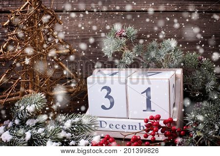 Calendar decorative tree berries and branches fur tree on aged wooden background. Selective focus. Drawn snow.