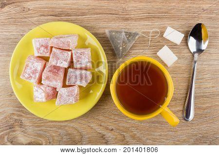 Tea, Sugar, Tea Bag, Yellow Saucer With Rakhat-lukum