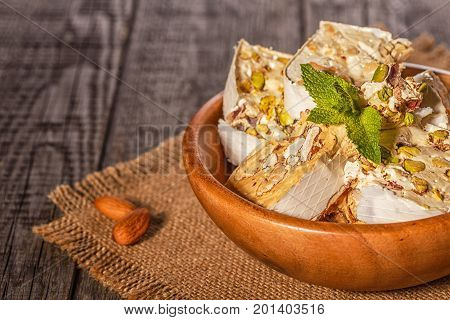Nougat with honey and nuts. Selective focus.