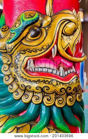 A Chinese Dragon Face on a temple pole